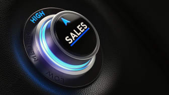 Finance and investment concept. Button on car dashboard. There is sales text on the button and it is pointing high efficiency. Horizontal composition with copy space and selective focus.